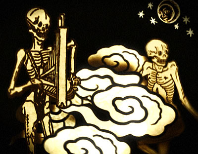 A sepia toned image showing skeletons dancing and playing musical instruments while smoke swirls around them.