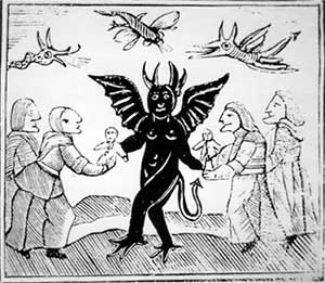 A woodcut of elderly witches meeting a black, winged devil while demons fly overheaad.