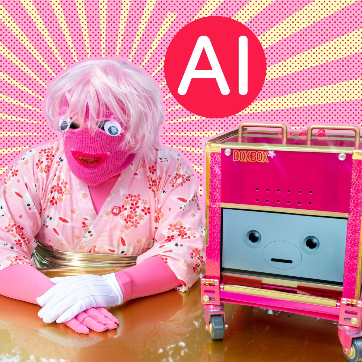 A character with a pink mask, googly eyes, a pink wig, pink kimono and one white glove sits at a gold desk next to a pink robot with a cute face. The letters AI float in a red circle above them.